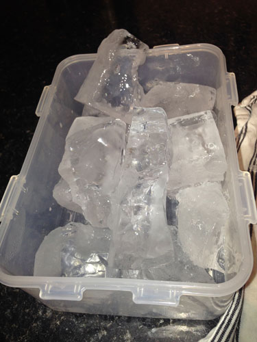 Clear ice in container
